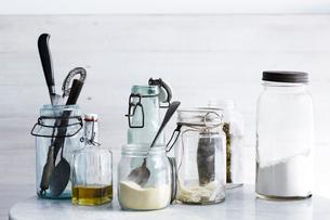 Jars of ingredients and kitchen utensilsの写真素材 [FYI03593262]