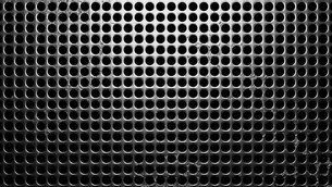Perforated  metal on black backgroundのイラスト素材 [FYI03593720]