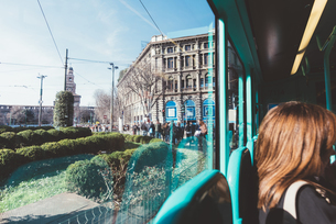 Cropped view of woman on bus, Milan, Lombardy, Italy, Europeの写真素材 [FYI03595078]