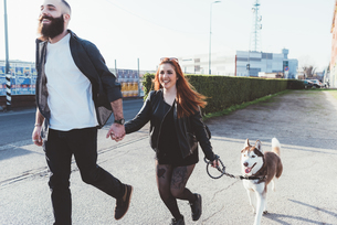 Couple walking with dog, Milan, Lombardia, Italy, Europeの写真素材 [FYI03595138]