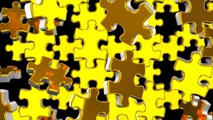 Golden Jigsaw Puzzle On Black Backgroundのイラスト素材 [FYI03595180]