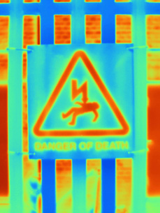 Thermal image of fence and warning sign at West London power stationの写真素材 [FYI03595506]