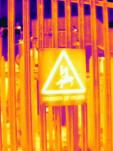 Thermal image of fence and warning sign at West London power stationの写真素材 [FYI03595508]