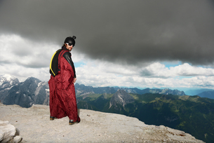 Base jumper on Dolomite mountains wearing wingsuit, Canazei, Trentino Alto Adige, Italy, Europeの写真素材 [FYI03597715]