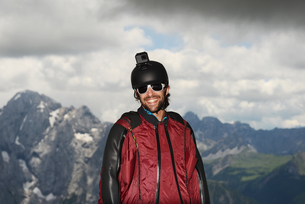 Portrait of base jumper wearing wingsuit with action camera on helmet, Dolomite mountains, Canazei,の写真素材 [FYI03597716]