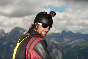 Portrait of base jumper wearing wingsuit with action camera on helmet, Dolomite mountains, Canazei,の写真素材 [FYI03597717]