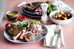 Steak meal for two on tableの写真素材 [FYI03597862]