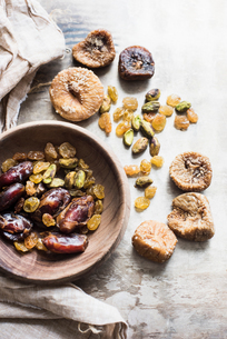 Mediterranean dried fruits in bowl, close-upの写真素材 [FYI03598038]
