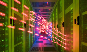 Interior of data centre, lights trails showing travelling dataの写真素材 [FYI03598077]