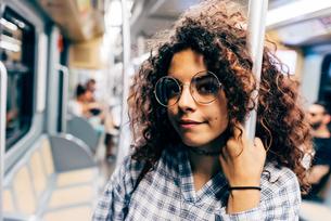 Woman in public transport, Milan, Italyの写真素材 [FYI03598705]