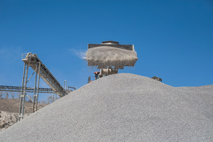 Heavy machinery at quarry, pouring aggregate onto pileの写真素材 [FYI03599445]