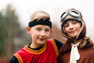 Portrait of boy and twin sister wearing basketball and pilot costumes for halloweenの写真素材 [FYI03599729]