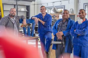 Portrait of male car mechanic team in repair garageの写真素材 [FYI03600067]