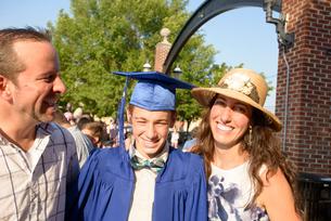 Teenage boy and family at graduation ceremonyの写真素材 [FYI03600302]