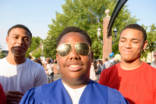 Teen boys at graduation ceremonyの写真素材 [FYI03600310]