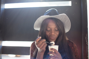 Young woman, eating dessert with spoonの写真素材 [FYI03600623]
