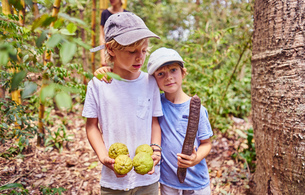Boys in jungle holding coconuts and seed, Aguas Calientes, Chuquisaca, Bolivia, South Americaの写真素材 [FYI03601329]
