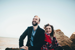 Mid adult couple laughing together on beach, Odessa Oblast, Ukraineの写真素材 [FYI03601930]