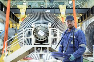 Crane operator with low pressure steam turbines in turbine maintenance factoryの写真素材 [FYI03602243]