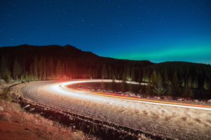 Northern lights, and long exposure light trails from vehicles on road, Nickel Plate Provincial Park,の写真素材 [FYI03603647]