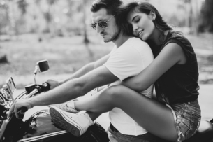 Young woman astride boyfriend on motorcycle, Krabi, Thailand, B&Wの写真素材 [FYI03604465]