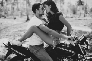 Young woman astride boyfriend on motorcycle, Krabi, Thailand, B&Wの写真素材 [FYI03604468]