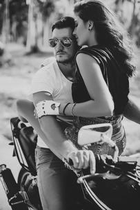 Young woman astride boyfriend on motorcycle, Krabi, Thailand, B&Wの写真素材 [FYI03604470]