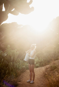 Woman looking at view from rural pathway, Tossa de mar, Catalonia, Spainの写真素材 [FYI03605143]
