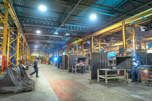 Wide angle view of welding bays in engineering factoryの写真素材 [FYI03605698]