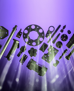 Machined metal parts against ultra violet backgroundの写真素材 [FYI03605708]