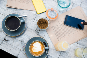 Coffee, mobile phone, menu on wooden tableの写真素材 [FYI03606141]