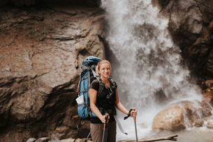 Hiker in front of waterfall, Annapurna Circuit, the Himalayas, Manang, Nepalの写真素材 [FYI03608642]