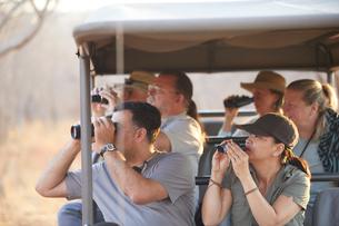 Tourists on safari tour, Victoria Falls, Zimbabweの写真素材 [FYI03608816]