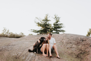 Couple with pet dog, Algonquin Park, Canadaの写真素材 [FYI03609219]
