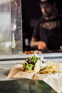 Man cooking in camper van food truckの写真素材 [FYI03610715]