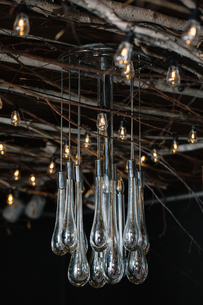 Retro decorative lights and glass chandelier hanging from rustic ceilingの写真素材 [FYI03611341]