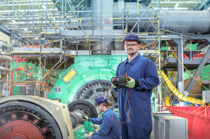 Portrait of engineer in turbine hall of nuclear power station during outageの写真素材 [FYI03612226]