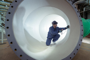 Testing protective paint in large pipe in turbine hall of nuclear power stationの写真素材 [FYI03612247]