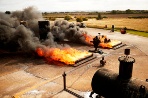 Firemen training, burning fires and smoke at training facilityの写真素材 [FYI03612283]