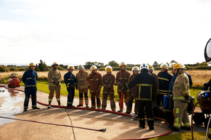 Firemen training, team of firemen listening to supervisor at training facilityの写真素材 [FYI03612288]