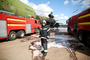 Fire training, fireman by fire engines at training facility, portraitの写真素材 [FYI03612297]