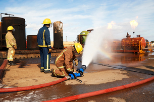 Firemen training to put out fire on burning tanks, Darlington, UKの写真素材 [FYI03612591]