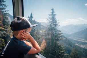 Boy contemplating view of valley, Bludenz, Vorarlberg, Austriaの写真素材 [FYI03612726]