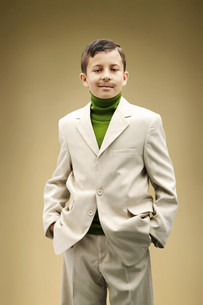 Young boy dressed in beige suit with fake mustacheの写真素材 [FYI03613587]