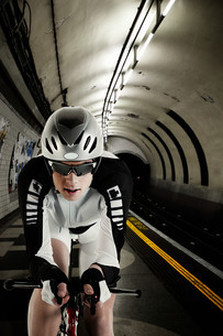 Cyclist cycling in London Underground tunnelの写真素材 [FYI03613644]