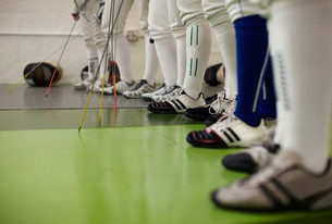 Female fencers standing together in a row, low sectionの写真素材 [FYI03614155]