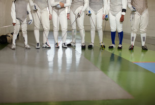Female fencers standing together in a row, low sectionの写真素材 [FYI03614156]