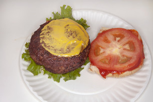 Hamburger with mustard and tomatoの写真素材 [FYI03614180]