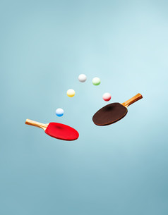 Table tennis bats and balls suspended in the airの写真素材 [FYI03614275]