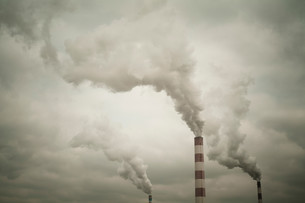 Industrial chimneys smokingの写真素材 [FYI03614441]